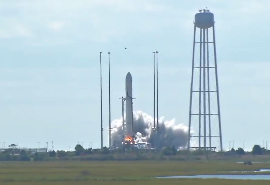 The Antares rocket's two AJ26 engines ignite on the launch pad.