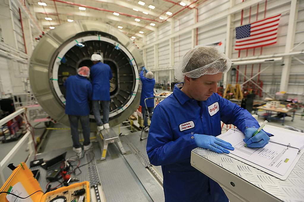Technicians loaded last-mnute cargo into the Cygnus spacecraft last week. Credit: Orbital Sciences Corp.