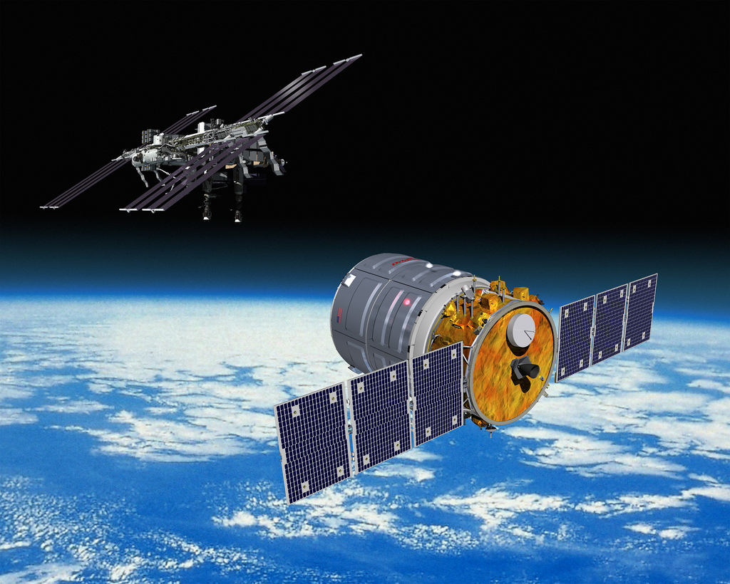 Artist's concept of a Cygnus supply spacecraft approaching the International Space Station. Credit: Orbital Sciences Corp.