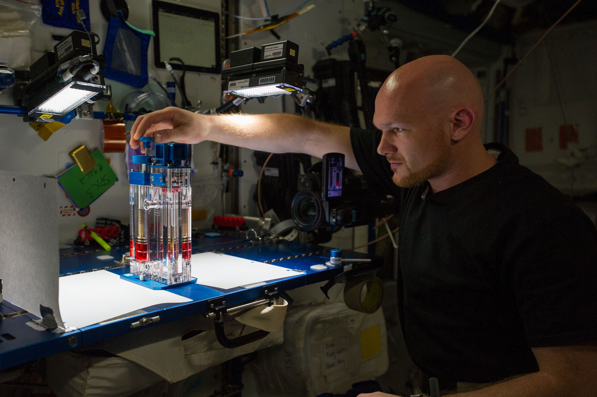 ESA astronaut Alexander Gerst works with a capillary flow experiment on the International Space Station. Credit: NASA