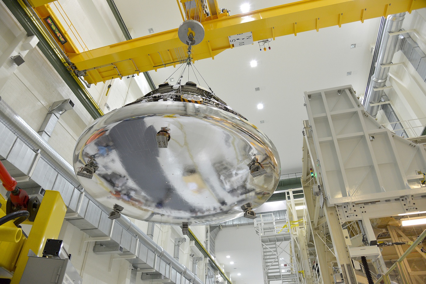 The Orion crew module for Exploration Flight Test 1 -- set for launch Dec. 4 -- is seen before attachment to its service module. The heat shield is covered in a reflective silver tape that protects it from the extreme cold temperatures of space. Credit: NASA