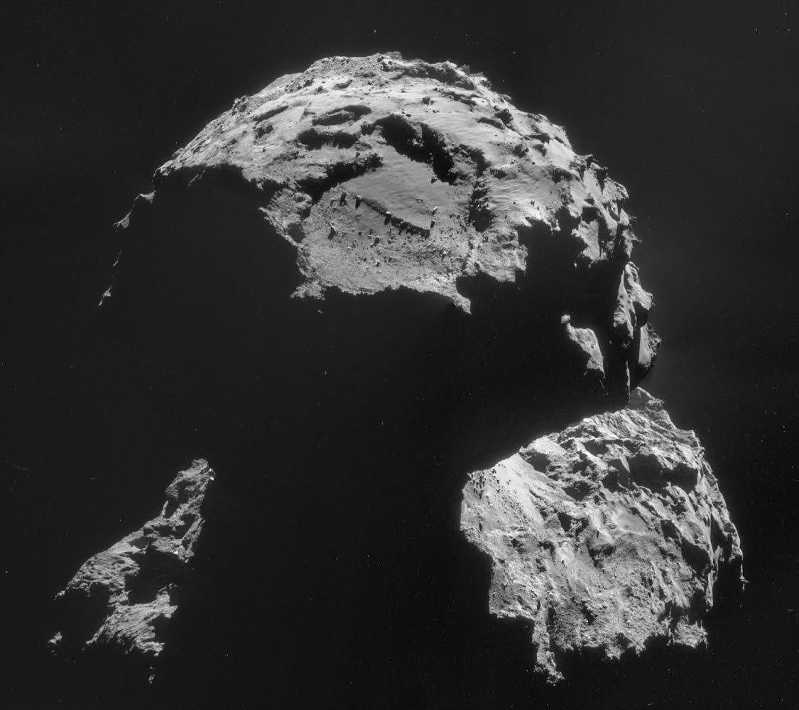 Philae's target -- named Agilkia -- is seen above the boulder-filled depression near the top of this image of comet 67P/Churyumov-Gerasimenko. Image credit: ESA/Rosetta/NAVCAM