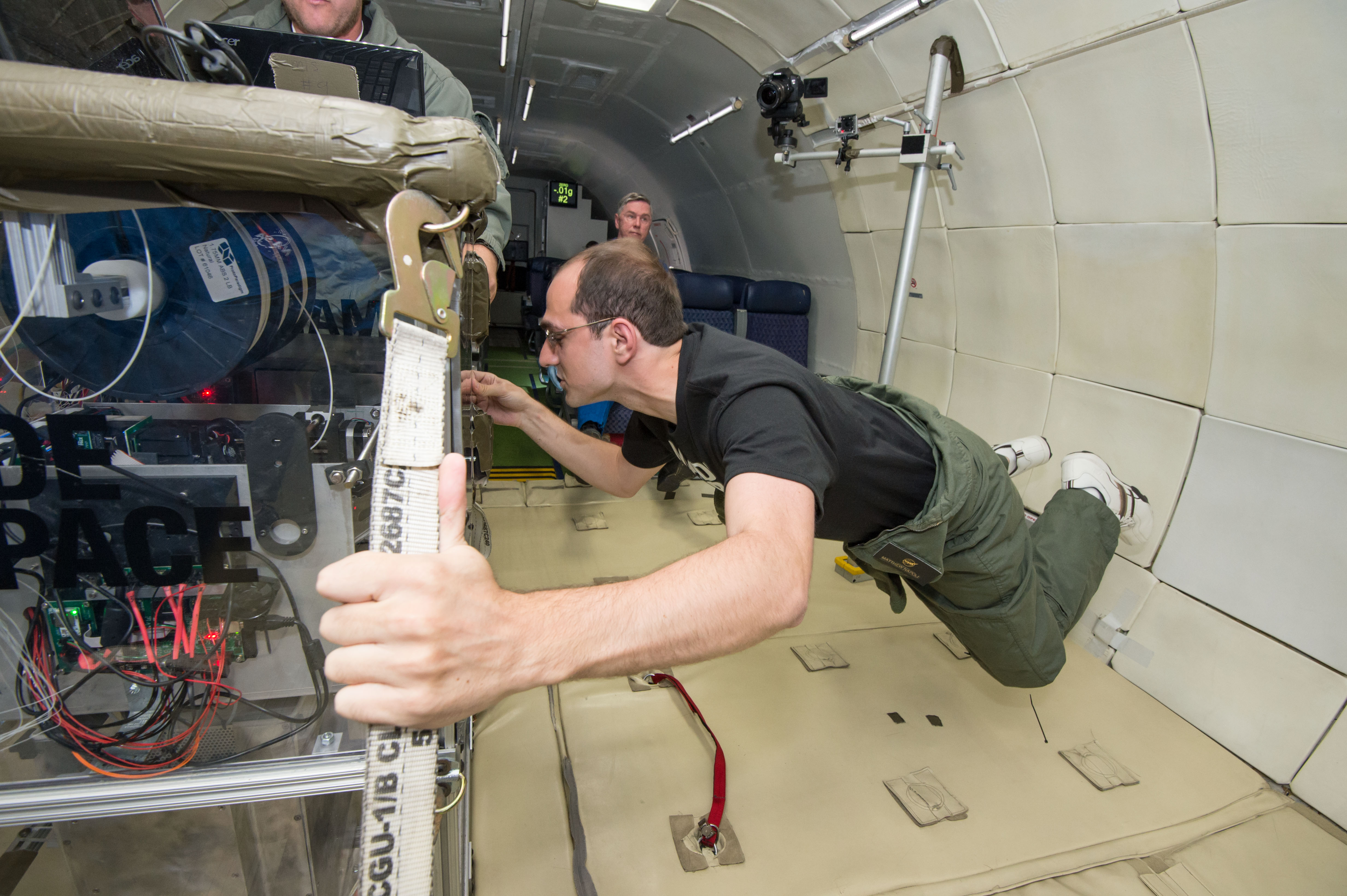 Engineers test the Made in Space printer on a Zero Gravity Corp. airplane. Credit: Made in Space