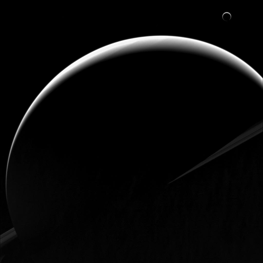 Saturn and Titan appear as crescents in this image from Cassini. Credit: NASA/JPL-Caltech/Space Science Institute