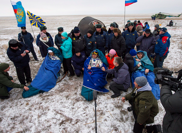The three-man Soyuz crew is greeted by Russian recovery teams in Kazakhstan. Credit: NASA/Bill Ingalls