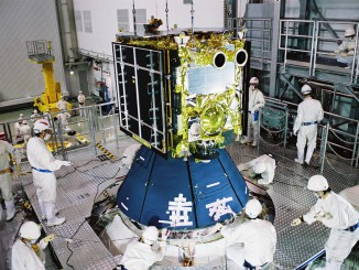 Japanese technicians attach the Hayabusa 2 spacecraft on top of its H-2A launcher. Credit: JAXA
