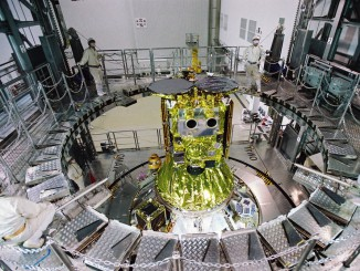 The Hayabusa 2 spacecraft is mated to the top of an H-2A launcher at the Tanegashima Space Center in Japan. Credit: JAXA