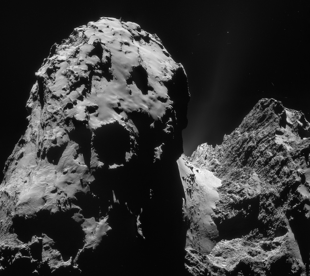 This four-image mosaic comprises images taken from a distance of 20.1 kilometers (12.5 miles) from the center of comet 67P/Churyumov-Gerasimenko on Dec. 10. Credit: ESA/Rosetta/NAVCAM
