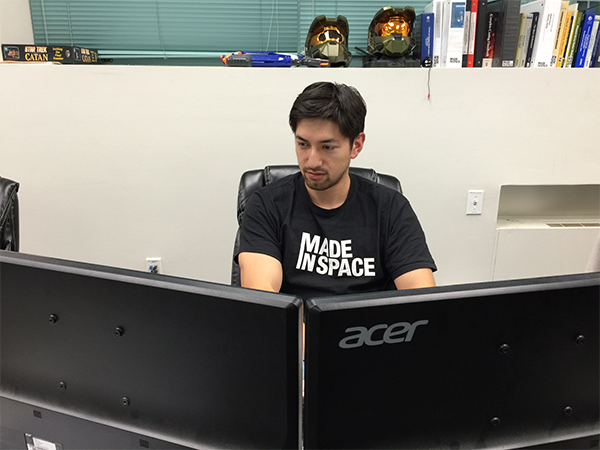 Made in Space engineer Noah Paul-Gin works on the design of the custom-made 3D printed ratchet wrench. Credit: Made in Space
