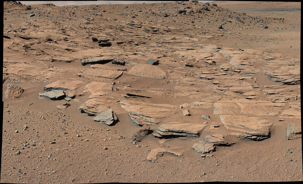 """This image taken by the Mast Camera (Mastcam) on NASA's Curiosity Mars rover just north of the """"Kimberley"""" waypoint shows beds of sandstone inclined to the southwest toward Mount Sharp and away from the Gale Crater rim. The inclination of the beds indicates build-out of sediment toward Mount Sharp. Credit: NASA/JPL-Caltech/MSSS"""