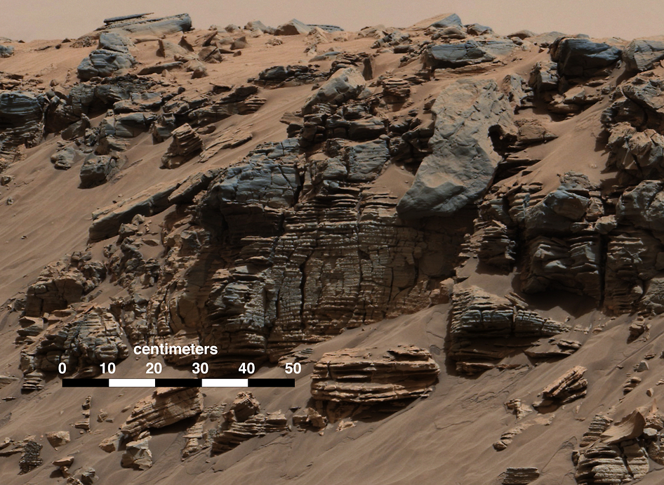 This evenly layered rock photographed by the Mast Camera (Mastcam) on NASA's Curiosity Mars Rover shows a pattern typical of a lake-floor sedimentary deposit not far from where flowing water entered a lake. Credit: Image Credit: NASA/JPL-Caltech/MSSS