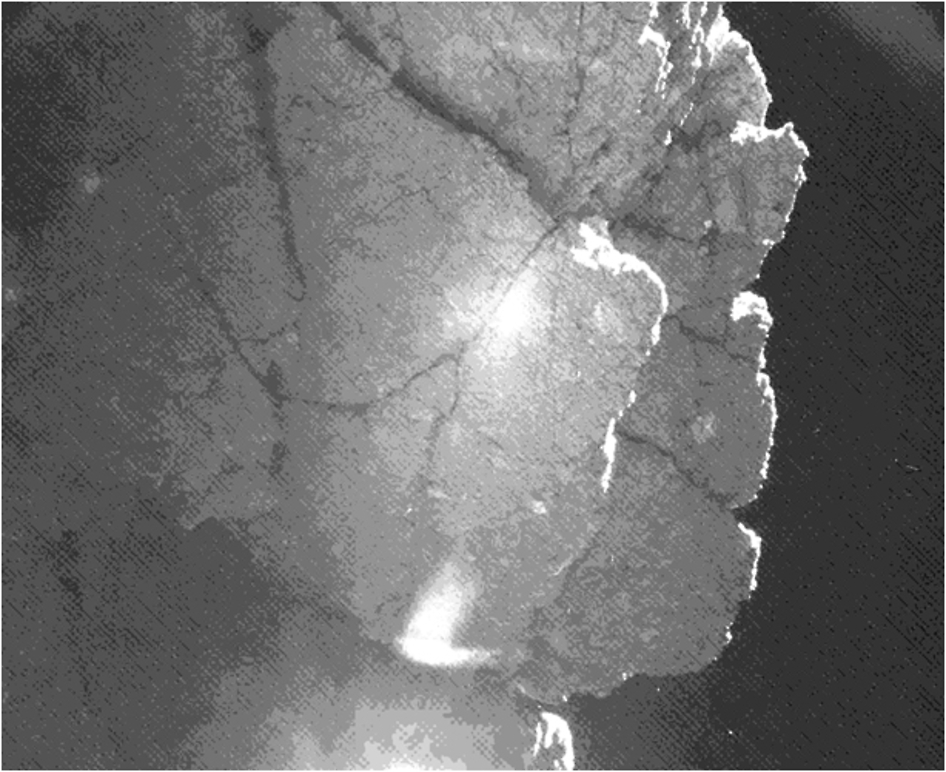 """From the location where it came to rest after bounces, the CIVA camera on Europe's Philae lander captured this view of a cliff on the nucleus of comet 67P/Churyumov-Gerasimenko. The feature is called """"Perihelion Cliff"""" and contains blocks of dust-covered ice separated by cracks, materials scientists are eager to analyze if Philae wakes up from hibernation. Credit: ESA/Rosetta/Philae/CIVA"""