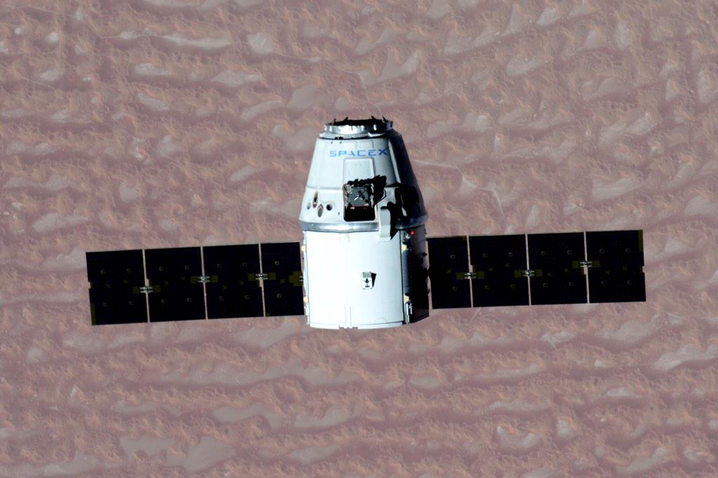 Astronaut Terry Virts tweeted this photo of SpaceX's Dragon spacecraft -- carrying 2.6 tons of supplies and research hardware -- on final approach to the International Space Station on Monday. Credit: Terry Virts/NASA