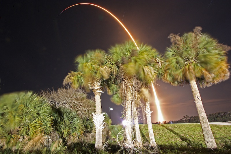 A Falcon 9 rocket streaks into orbit Jan. 10 in this long exposure photograph from Kennedy Space Center's press site. Credit: Stephen Clark/Spaceflight Now
