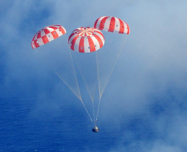 The Orion spacecraft descends under three main parachutes at the end of its first mission into space Dec. 5. Credit: U.S. Navy Photo by Mass Communication Specialist 1st Class Charles White