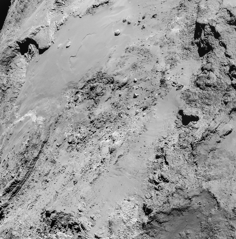 A four-image mosaic of comet 67P/Churyumov-Gerasimenko taken by Rosetta's navigation camera at a distance of 8.9 kilometers (5.5 miles) from the surface. The image is centered on the comet's Imhotep region, located on 67P's large lobe. Credit: ESA/Rosetta/NAVCAM