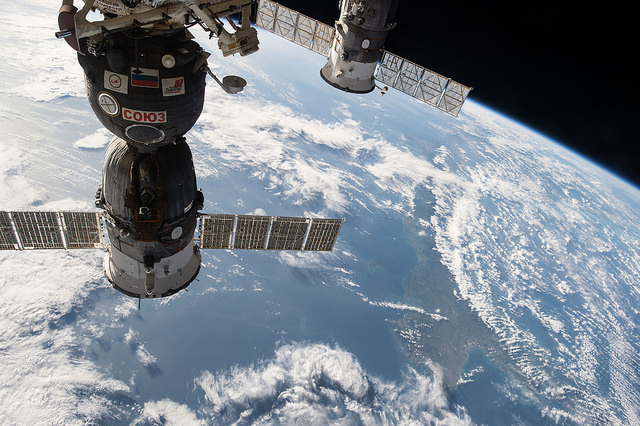 A Russian Soyuz spacecraft (left) and Progress supply ship (right) docked to the International Space Station. Credit: NASA