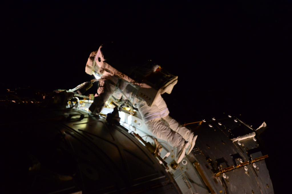 Astronaut Terry Virts works outside the International Space Station. Credit: Samantha Cristoforetti/ESA/NASA