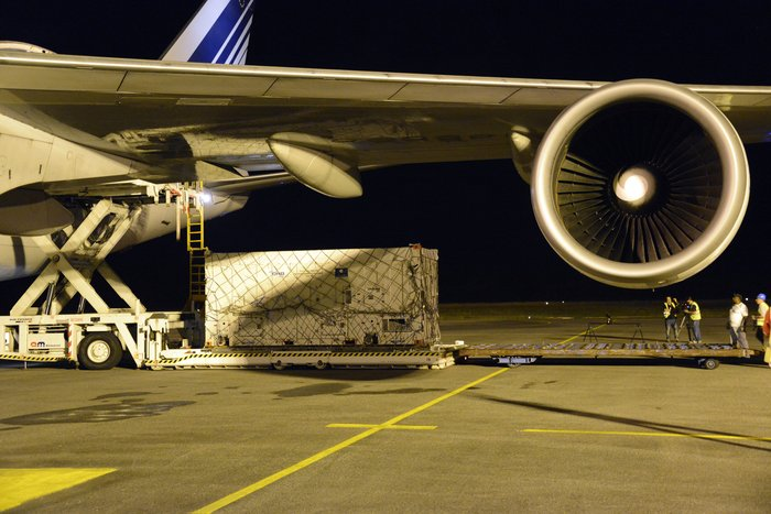 One of two Galileo satellites is unloaded from an Air France Boeing 747 cargo plane on Thursday after arrival in Cayenne, French Guiana. Credit: ESA/Paul Muller