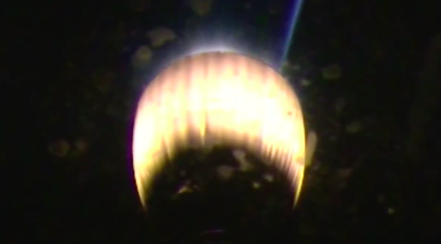 The Falcon 9's second stage Merlin engine restarts to propel the Thaicom 8 communications satellite into a geosynchronous transfer orbit.