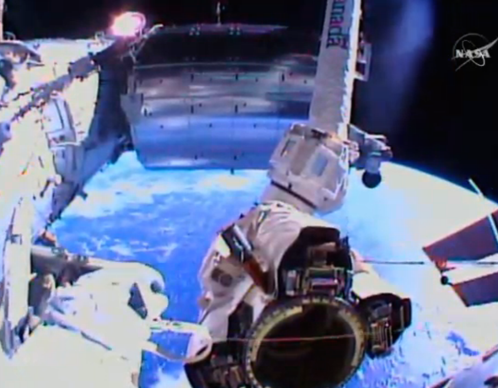A view from Virts' helmet-mounted camera shows the Latching End Effector of the space station's robot arm. Credit: NASA TV/Spaceflight Now