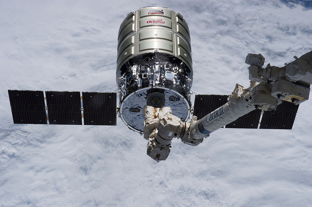 An Orbital ATK Cygnus spacecraft is grappled by the space station's robotic arm in July 2014. Credit: NASA