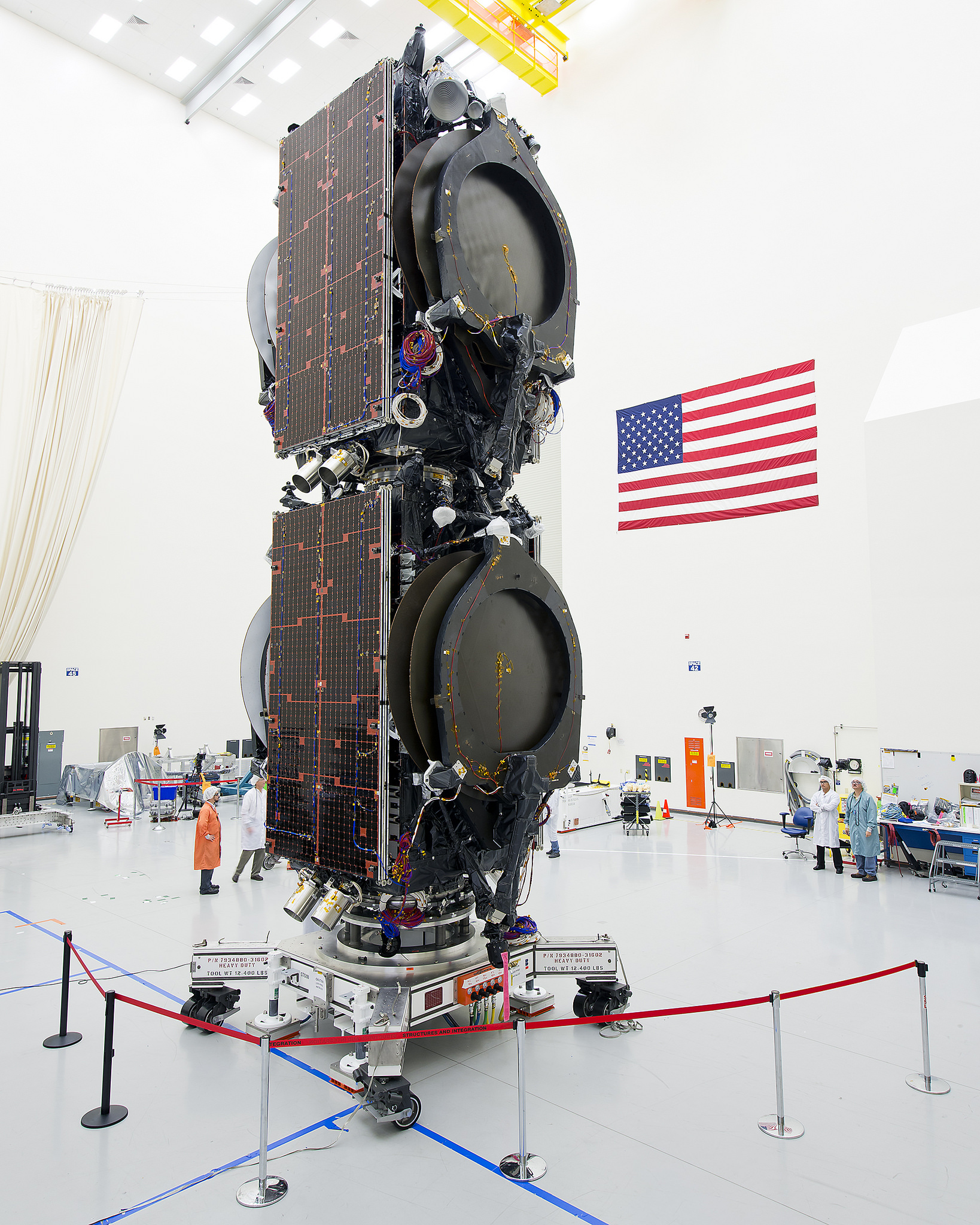 The ABS 3A satellite (top) and the Eutelsat 115 West B satellite (bottom) are stacked inside Boeing's factory in El Segundo, California. Credit: Boeing
