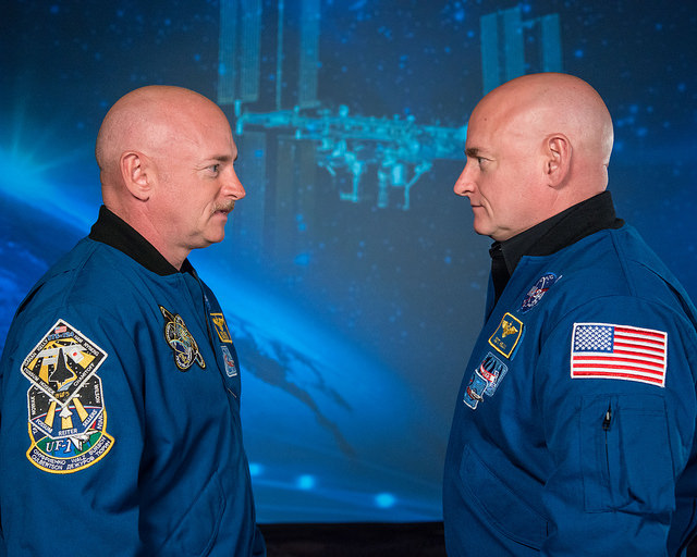 Researchers will study Scott Kelly (right) and his twin brother former astronaut Mark Kelly (left) to study how two people with the same genetics respond differently to living on Earth and in space. Credit: Robert Markowitz