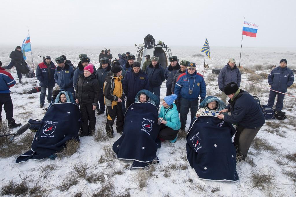 Elena Serova, Alexander Samokutyaev and Butch Wilmore recline after exiting their Soyuz spacecraft following landing. Credit: NASA/Bill Ingalls