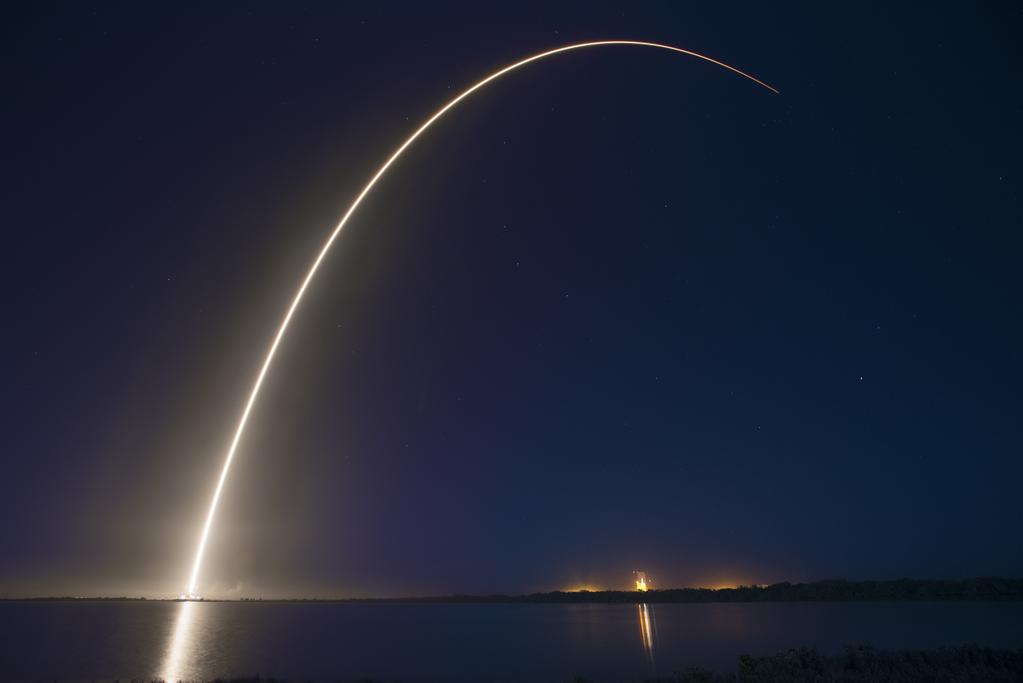 The Falcon 9 rocket streaks downrange in this long exposure photograph. Credit: SpaceX
