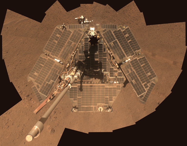 This self-portrait of NASA's Mars Exploration Rover Opportunity shows effects of wind events that had cleaned much of the accumulated dust off the rover's solar panels. The image combines multiple frames taken by Opportunity's panoramic camera in March 2014. Credit: NASA/JPL-Caltech/Cornell Univ./Arizona State Univ.