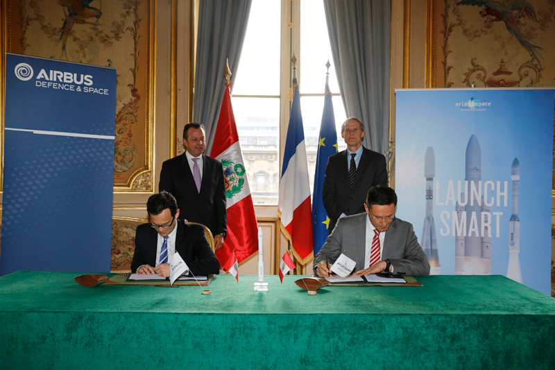 Arianespace chairman and CEO Stephane Israel (left) and Airbus Defense and Space head of space programs Eric Beranger sign the launch contract for PeruSat 1 at the French Ministry of Foreign Affairs in Paris. Credit: Airbus Defense and Space