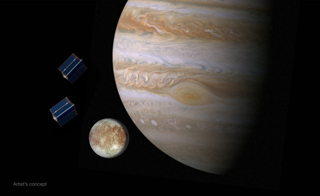 Artist's concept of CubeSats at Jupiter and Europa. NASA awarded funding to 10 university teams last year to study CubeSat proposals that could be carried to Europa. Credit: NASA/JPL-Caltech