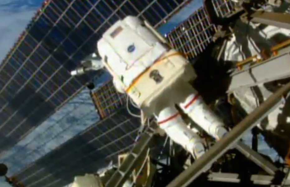 Astronaut Terry Virts outside the International Space Station on Sunday's spacewalk. Credit: NASA TV/Spaceflight Now