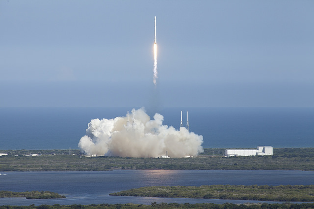 A Falcon 9 rocket climbs away from Cape Canaveral in this photo from the roof of Kennedy Space Center's iconic Vehicle Assembly Building. Credit: NASA/Kim Shiflett