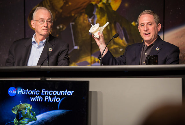 New Horizons principal investigator Alan Stern holds a model of the spacecraft during a press briefing at NASA Headquarters on April 14. Credit: NASA/Joel Kowsky