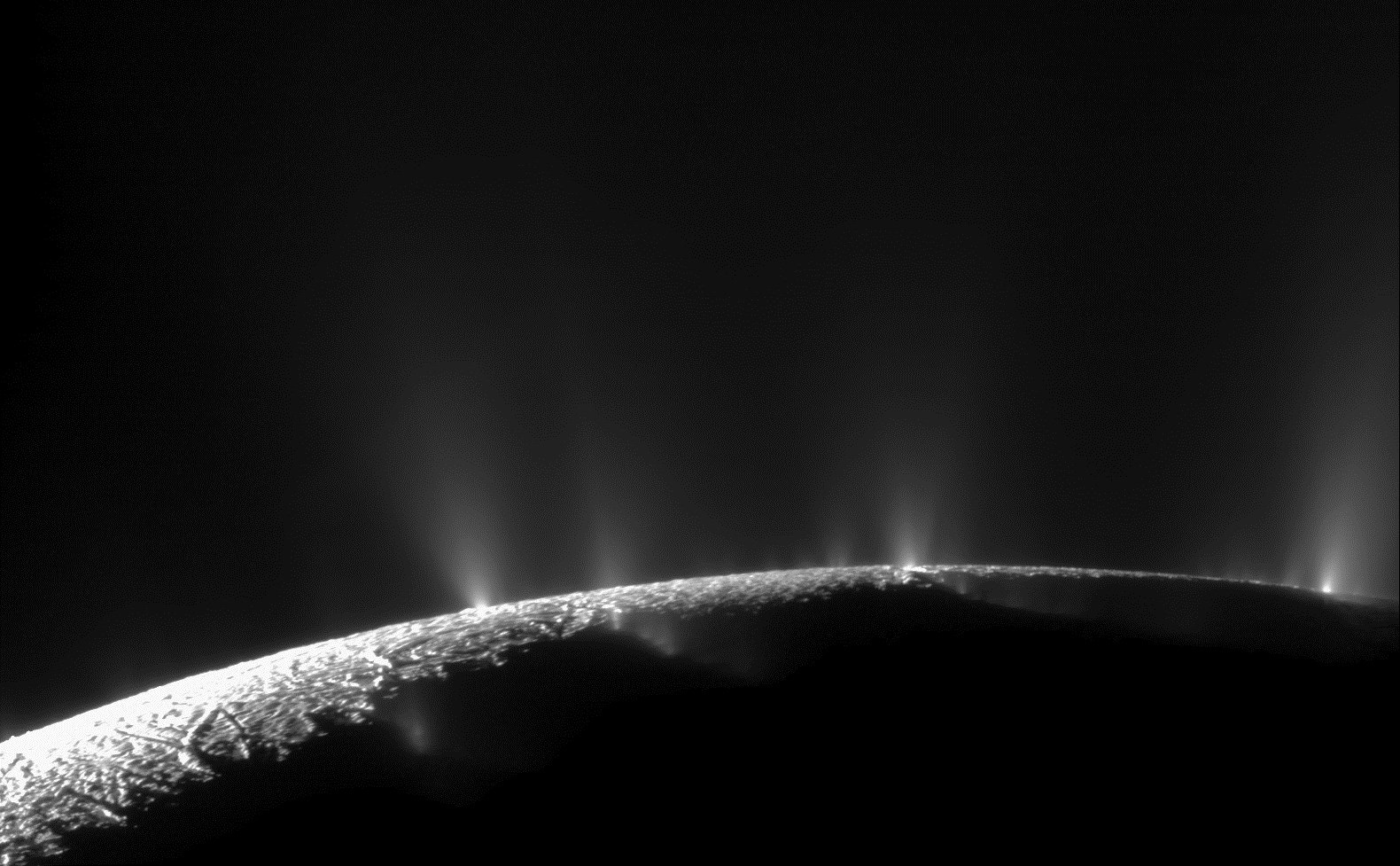 "Dramatic plumes, both large and small, spray water ice and vapor from many locations along the famed ""tiger stripes"" near the south pole of Saturn's moon Enceladus. Credit: NASA/JPL-Caltech/SSI"