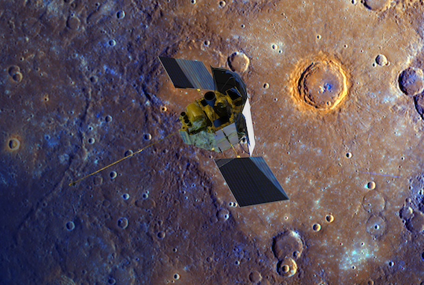 Artist's concept of the Messenger spacecraft flying over Mercury's surface displayed in enhanced color. The crater ringed by bright orange is Calvino crater. Credit: NASA/Johns Hopkins University Applied Physics Laboratory/Carnegie Institution of Washington