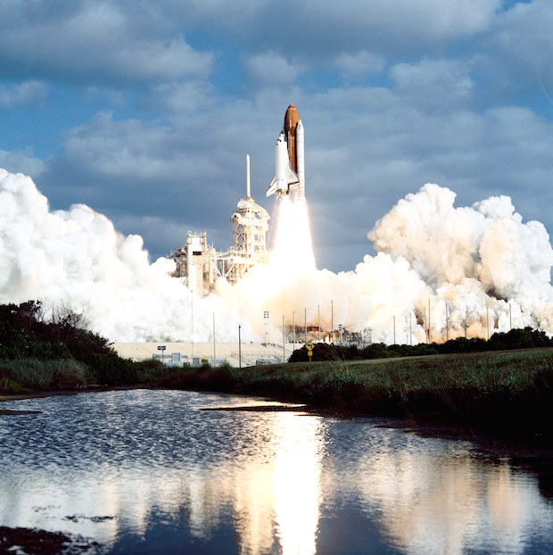 Space shuttle Discovery blasted off April 24, 1990, with the Hubble Space Telescope. Credit: NASA