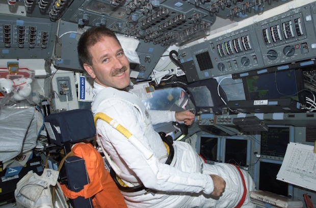 Astronaut-astronomer John Grunsfeld flew on three shuttle repair flights to Hubble. He is seen here on the flight deck of space shuttle Columbia in 2002. Credit: NASA