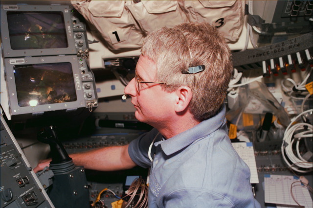 Astronaut Steve Hawley at the controls of space shuttle Discovery's robotic arm during the second Hubble repair flight in 1997. Credit: NASA