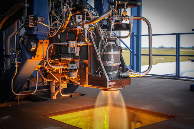 A SuperDraco rocket thruster fires during a ground test. Credit: SpaceX