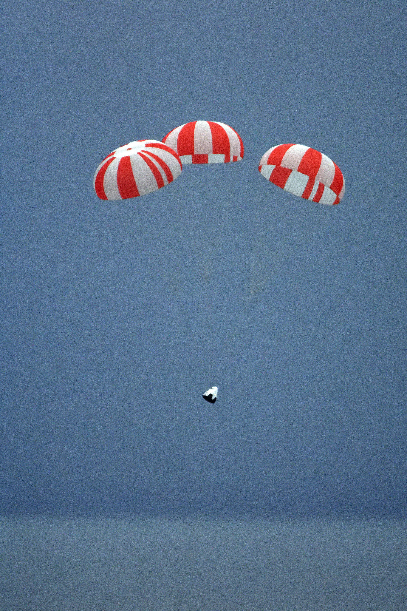 The initial flights of SpaceX's crew-carrying Dragon spacecraft will return to Earth with parachute-assisted splashdowns in the ocean. Credit: SpaceX