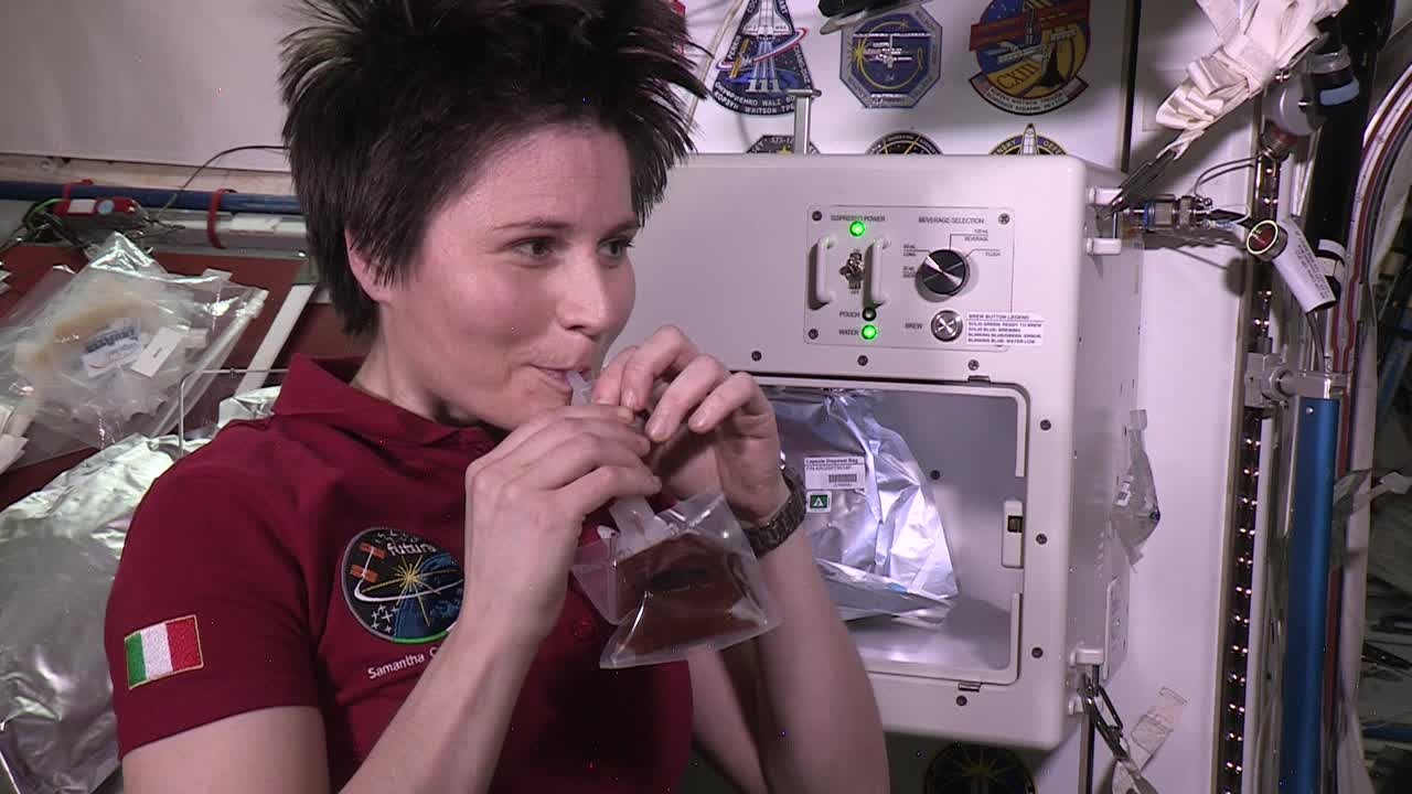 Astronaut Samantha Cristoforetti sips espresso on the International Space Station. Credit: Argotec