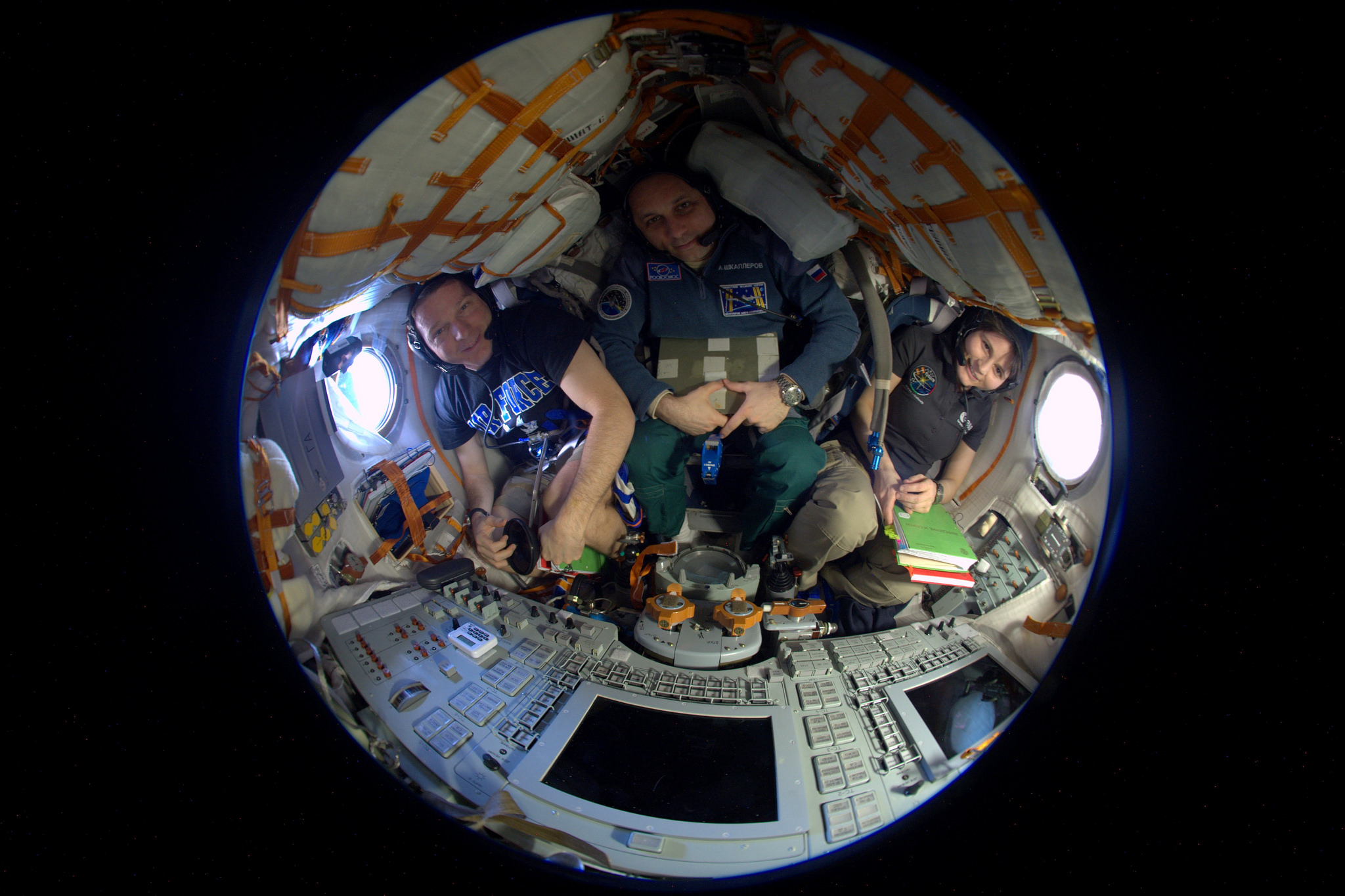Virts, Shkaplerov and Cristoforetti strapped into their Soyuz landing craft earlier this week for systems tests. Credit: NASA/ESA