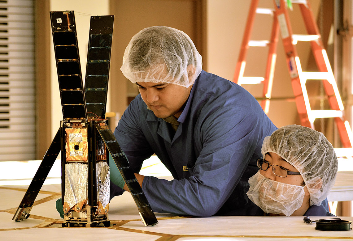 Engineers work on the LightSail spacecraft before launch. Credit: The Planetary Society