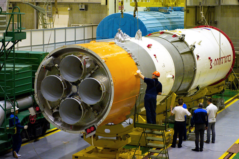 Russian technicians work on the third stage of the Soyuz-2.1a rocket and Progress M-27M spacecraft before their doomed April 28 launch from the Baikonur Cosmodrome in Kazakhstan. Credit: Energia