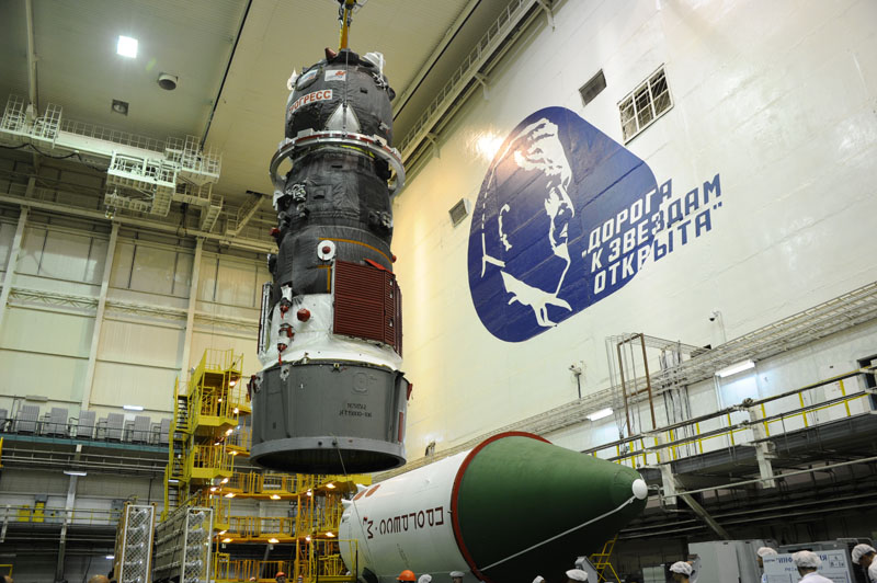 Russian ground crews prepare the Progress M-28M spacecraft for launch in a hangar at the Baikonur Cosmodrome in Kazakhstan. The mission is set for launch July 3. Credit: Energia