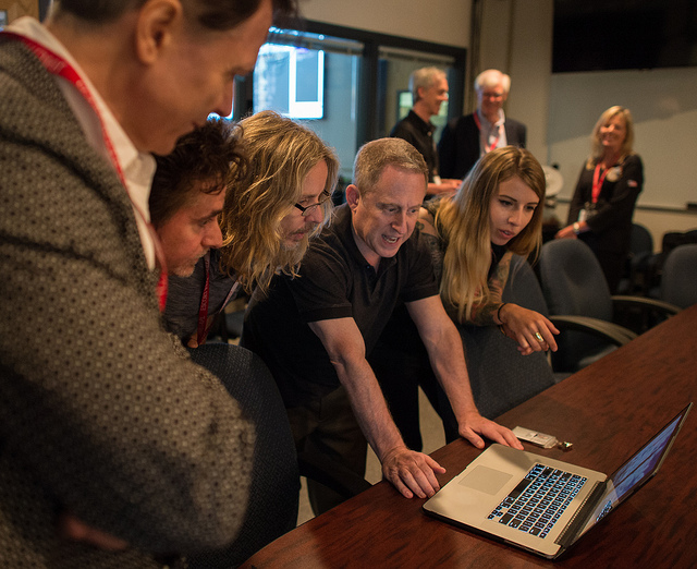 Alan Stern (second from right) visits with members of the band Styx, who visited members of the New Horizons team in Maryland on July 1. Pluto's fifth moon is named Styx. Credit: NASA/Joel Kowsky