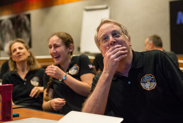 New Horizons scientists react to a new image of Pluto, the best ever view of the distant world three billion miles from Earth. Credit: NASA/Bill Ingalls